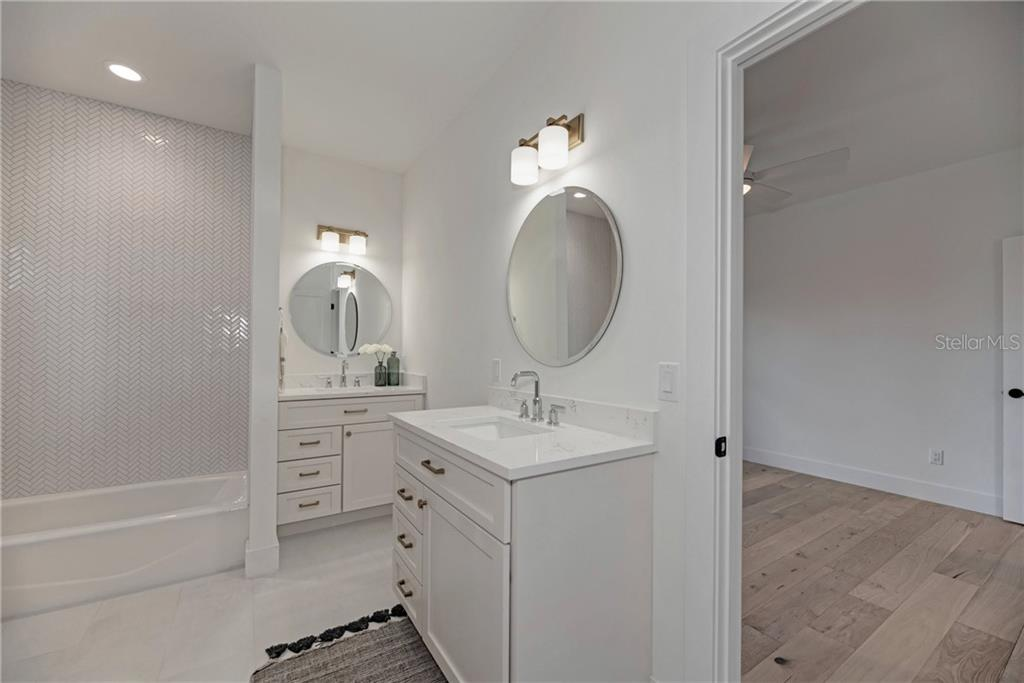 J&J Bathroom - Single Family Home for sale at 5035 Sandy Beach Ave, Sarasota, FL 34242 - MLS Number is A4445640