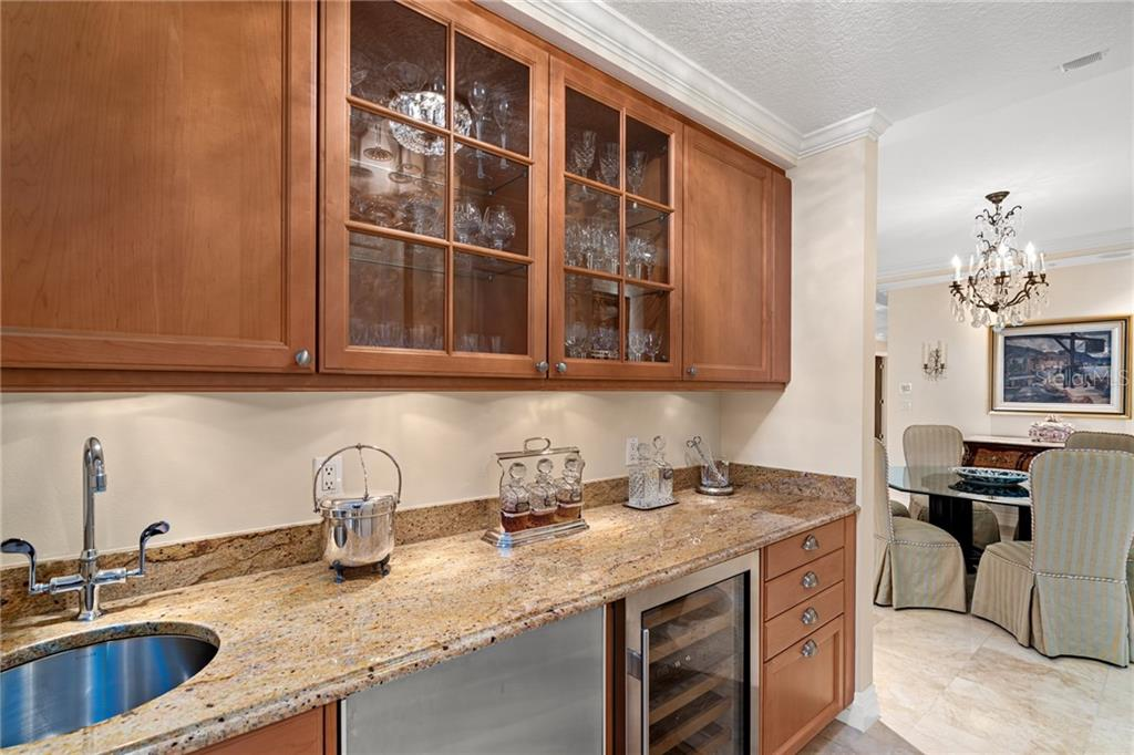 Adjacent to the formal dining space, a large butler's pantry area boasts stainless steel refrigeration, Sub Zero wine cooler and ample storage. - Condo for sale at 401 S Palm Ave #402, Sarasota, FL 34236 - MLS Number is A4446224