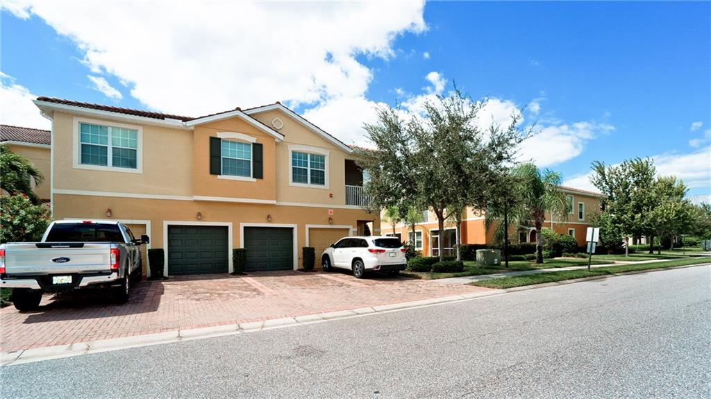 One car garage is 2nd from left (1st green door) - Condo for sale at 7815 Moonstone Dr #24-204, Sarasota, FL 34233 - MLS Number is A4446867