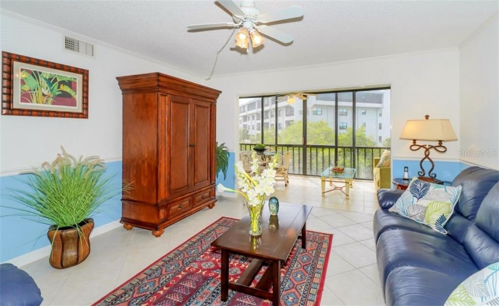 Living Room and Lanai - Condo for sale at 5855 Midnight Pass Rd #429, Sarasota, FL 34242 - MLS Number is A4446942