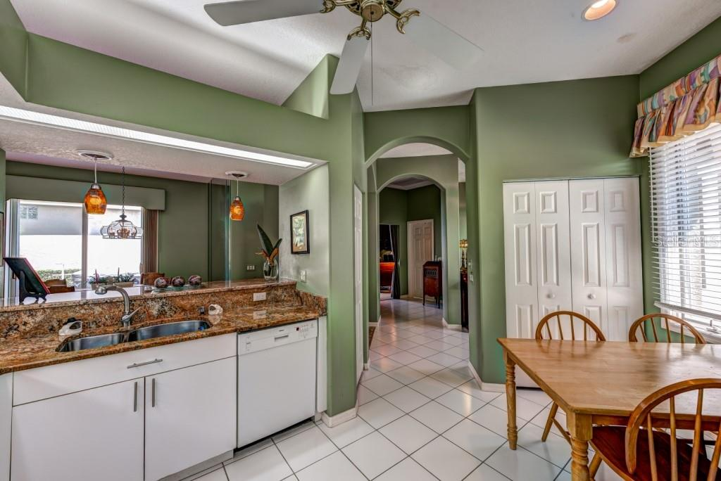 Kitchen is open to the greatroom. - Single Family Home for sale at 8727 53rd Ter E, Bradenton, FL 34211 - MLS Number is A4447005