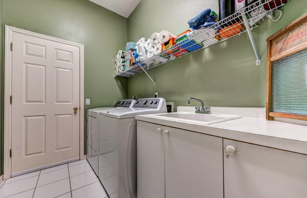 Good size laundry room with extra storage and laundry tub, leads to attached 2 car garage - Single Family Home for sale at 8727 53rd Ter E, Bradenton, FL 34211 - MLS Number is A4447005