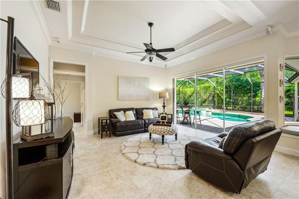 Single Family Home for sale at 6819 Turnberry Isle Ct, Lakewood Ranch, FL 34202 - MLS Number is A4447178