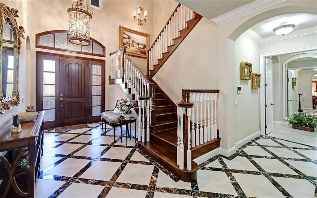 Grand entry & staircase - Single Family Home for sale at 7903 Longbay Blvd, Sarasota, FL 34243 - MLS Number is A4449717