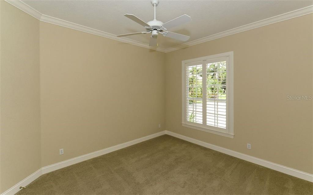 Bedroom 3 - Single Family Home for sale at 586 N Macewen Dr, Osprey, FL 34229 - MLS Number is A4451482