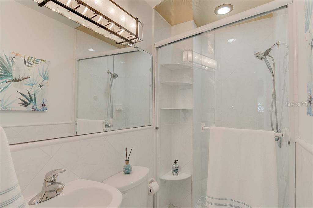 Second Bath with walk in shower - Single Family Home for sale at 867 N Shore Dr, Anna Maria, FL 34216 - MLS Number is A4454292