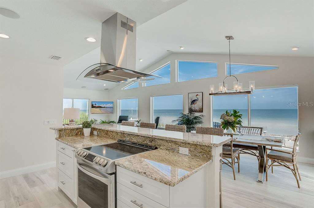 Kitchen over looks breathtaking views - Single Family Home for sale at 867 N Shore Dr, Anna Maria, FL 34216 - MLS Number is A4454292
