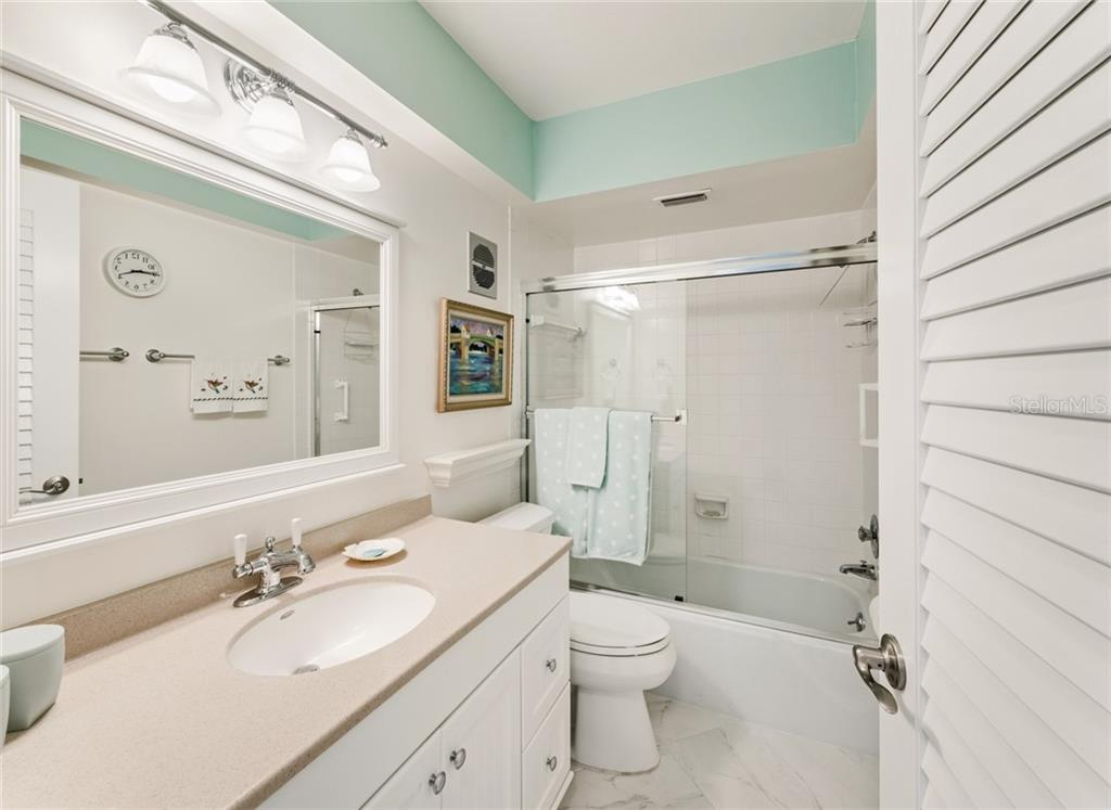 Guest Bathroom - Condo for sale at 3330 Gulf Of Mexico Dr #305-D, Longboat Key, FL 34228 - MLS Number is A4454357