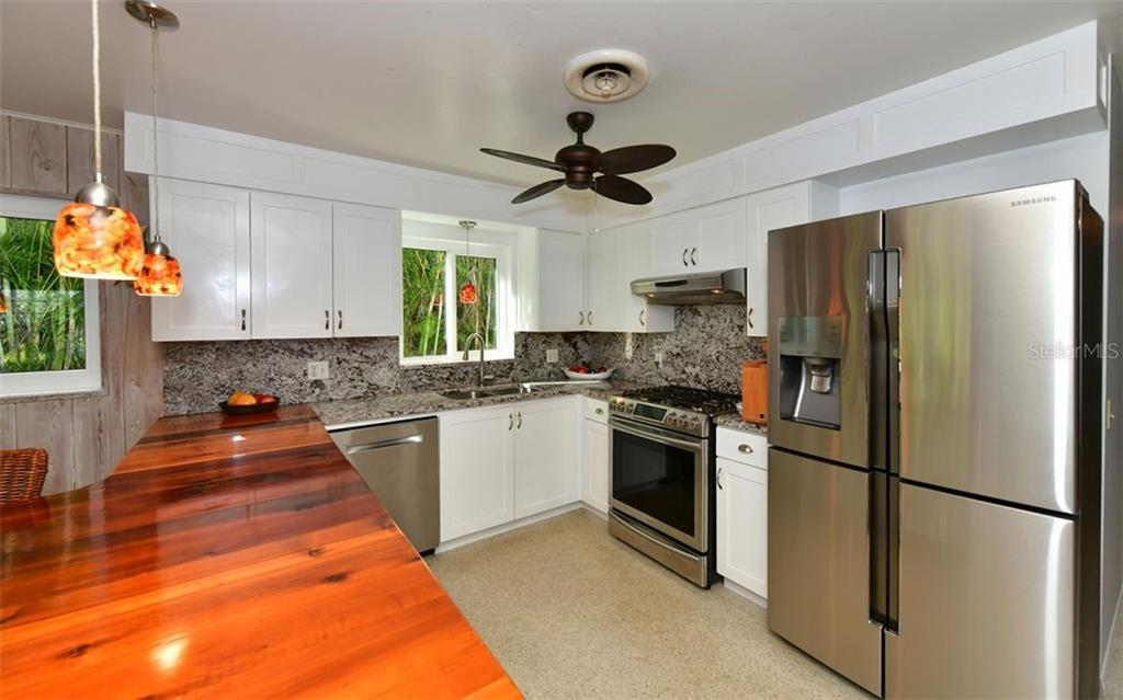 Granite counter and back-splash and stainless steel appliances, gas range - Single Family Home for sale at 623 Avenida Del Norte, Sarasota, FL 34242 - MLS Number is A4454692