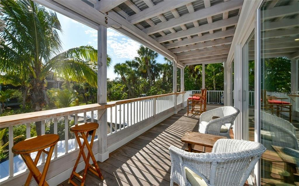 Front deck with cypress beam roofing, Cumaru (sustainable Brazilian hard wood) decking - Single Family Home for sale at 623 Avenida Del Norte, Sarasota, FL 34242 - MLS Number is A4454692