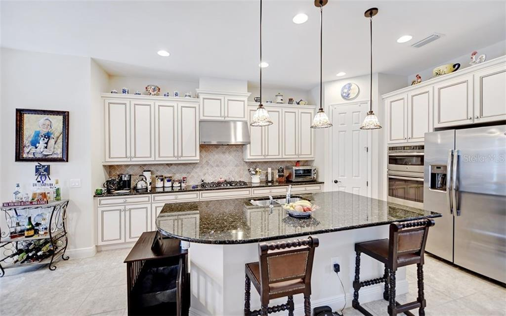 Bright kitchen...gas range! Stacked ovens! - Single Family Home for sale at 8260 Larkspur Cir, Sarasota, FL 34241 - MLS Number is A4455087
