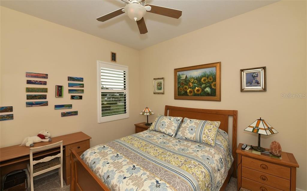 Bedroom 2 - Single Family Home for sale at 8260 Larkspur Cir, Sarasota, FL 34241 - MLS Number is A4455087