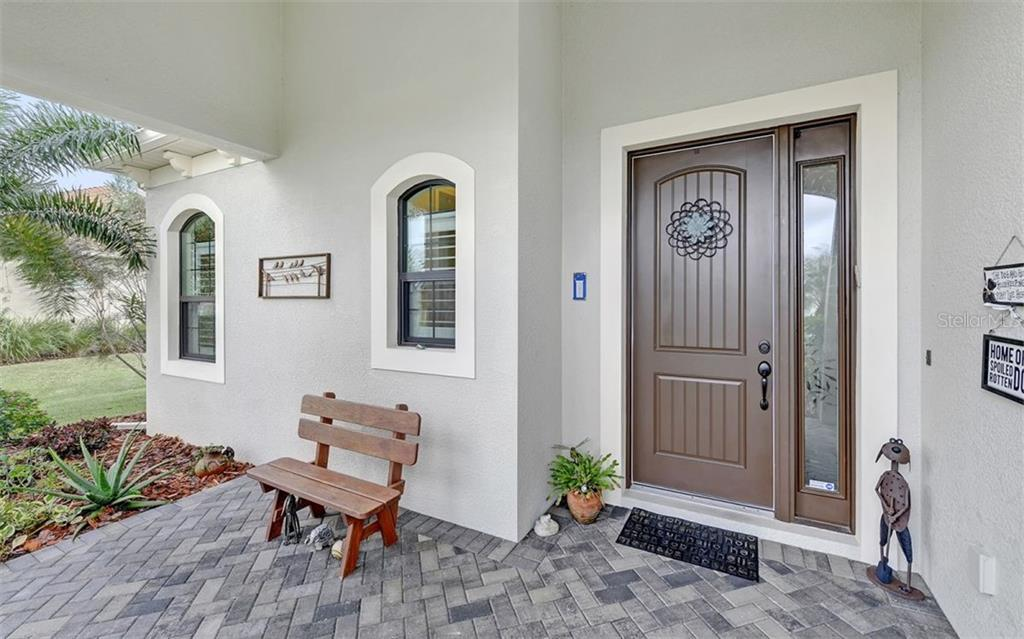 Have a seat and enjoy the lake view! - Single Family Home for sale at 8260 Larkspur Cir, Sarasota, FL 34241 - MLS Number is A4455087