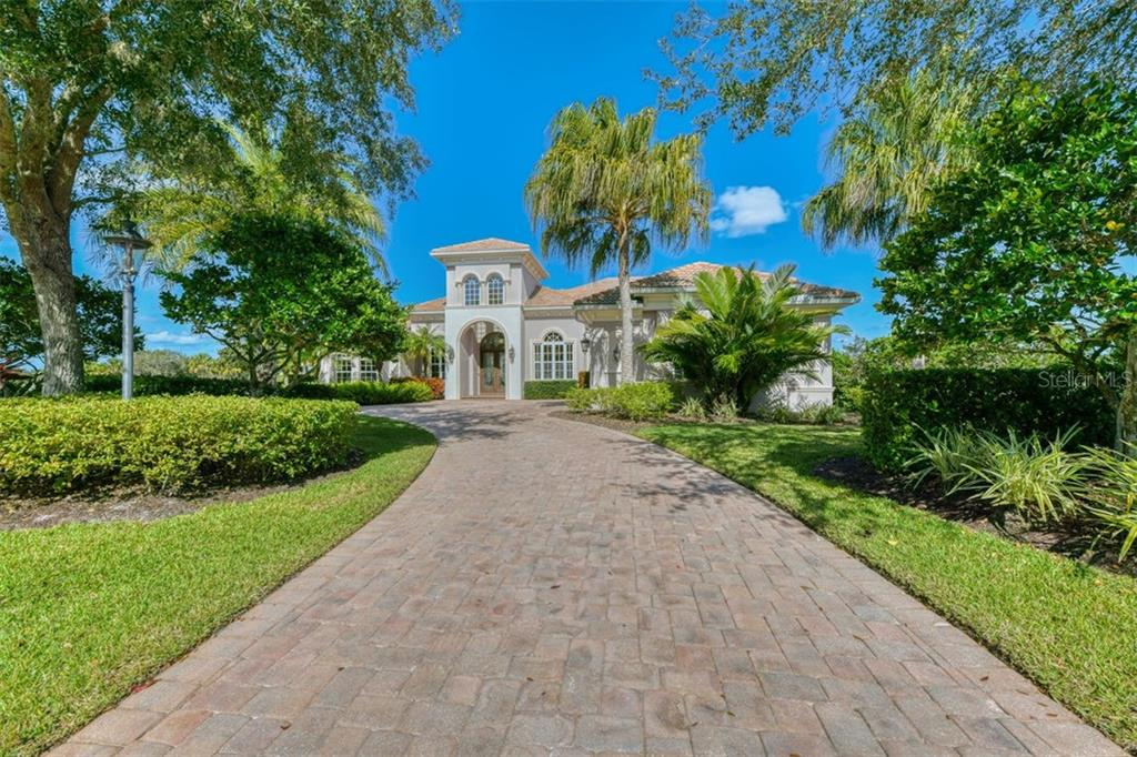 The long semi-circular driveway - Single Family Home for sale at 3719 Founders Club Dr, Sarasota, FL 34240 - MLS Number is A4455099