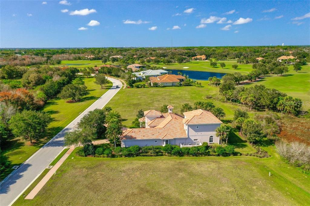 Looking west over the house along Founders Club Drive and the golf course - Single Family Home for sale at 3719 Founders Club Dr, Sarasota, FL 34240 - MLS Number is A4455099