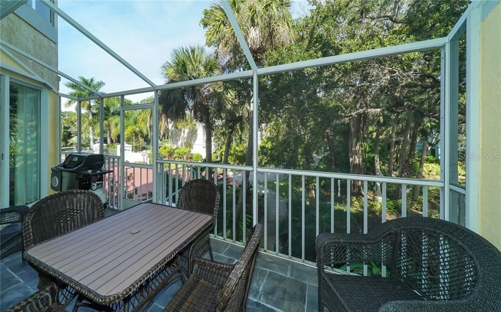 Screen lanai w/grilling allowed. Overlooks pond. - Condo for sale at 3994 Hamilton Club Cir #18, Sarasota, FL 34242 - MLS Number is A4455281