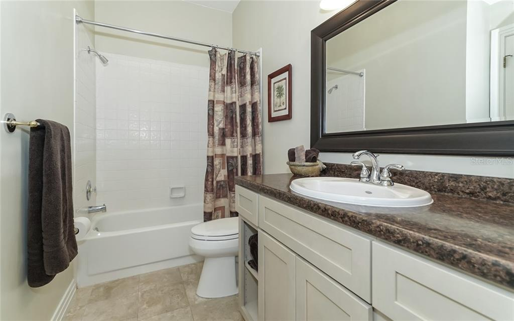 2nd bath adjacent guest BR downstairs - Condo for sale at 3994 Hamilton Club Cir #18, Sarasota, FL 34242 - MLS Number is A4455281