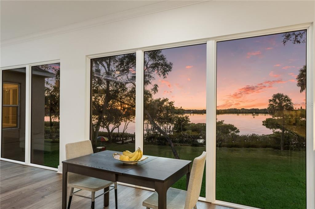 What a view from the kitchen! - Single Family Home for sale at 6125 1st Ter E, Palmetto, FL 34221 - MLS Number is A4455618