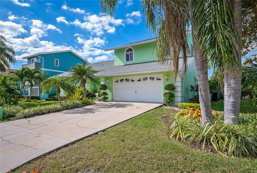 Single Family Home for sale at 609 N Point Dr, Holmes Beach, FL 34217 - MLS Number is A4455659