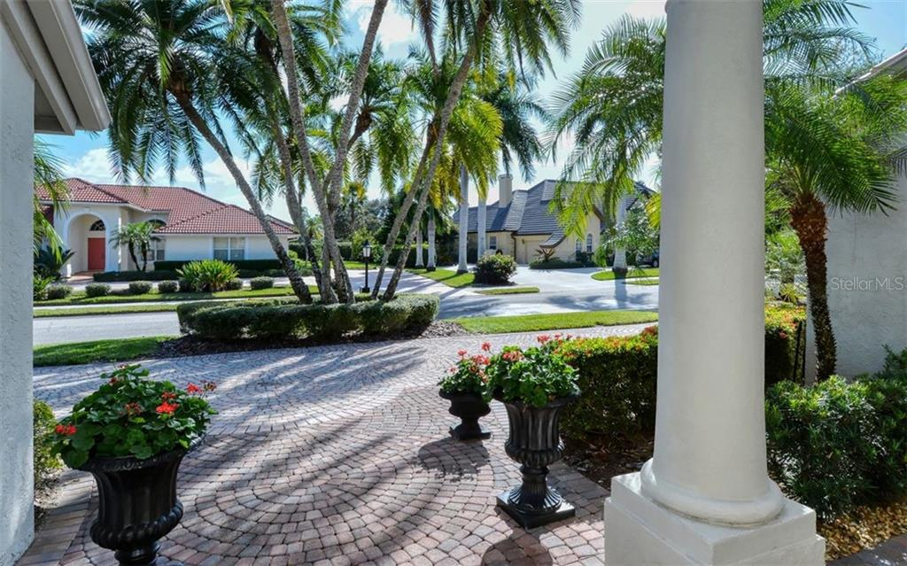 Paver entry and circular driveway. - Single Family Home for sale at 4177 Escondito Cir, Sarasota, FL 34238 - MLS Number is A4456531