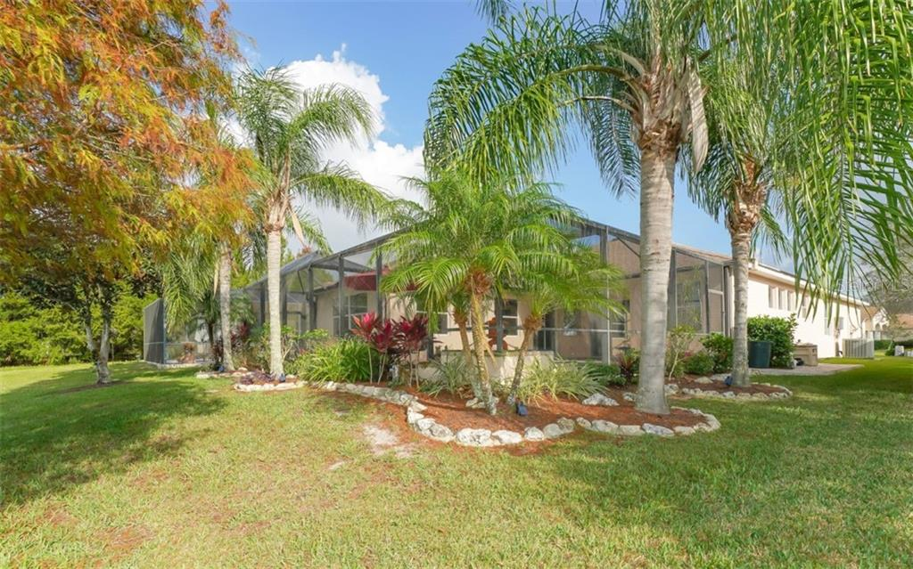 Large lanai and pool with a waterfall at the end overlooks a lake - Single Family Home for sale at 6510 Field Sparrow Gln, Lakewood Ranch, FL 34202 - MLS Number is A4457243