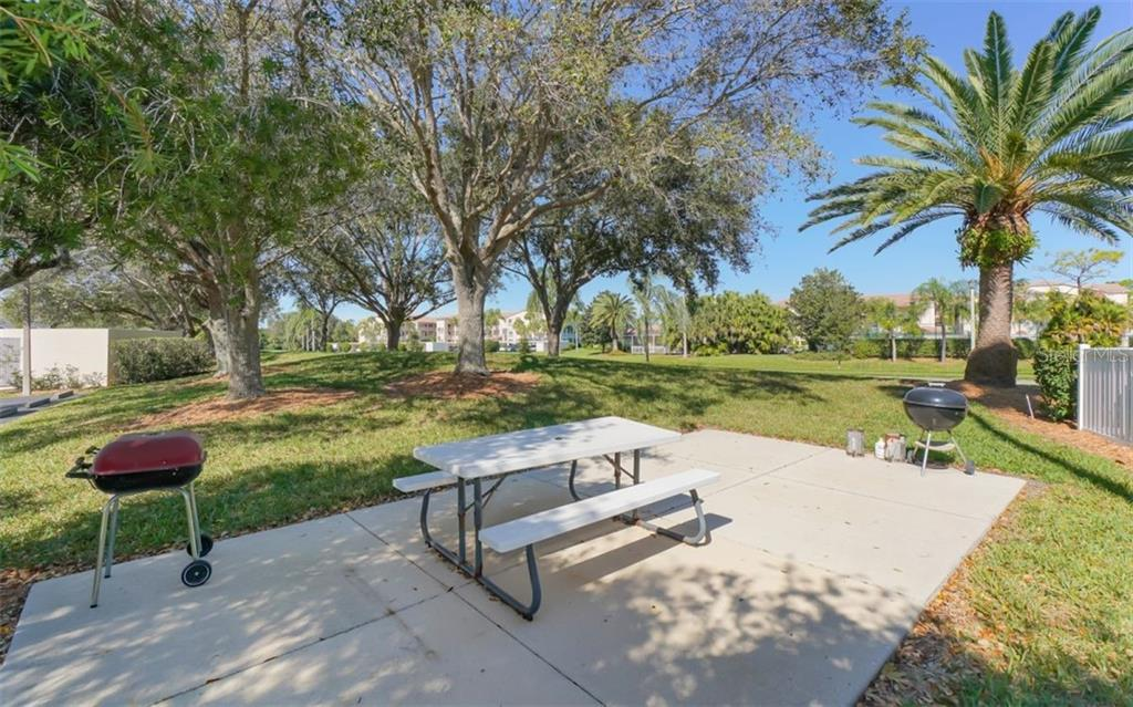 View toward the 4th green - Condo for sale at 9631 Castle Point Dr #1123, Sarasota, FL 34238 - MLS Number is A4457428