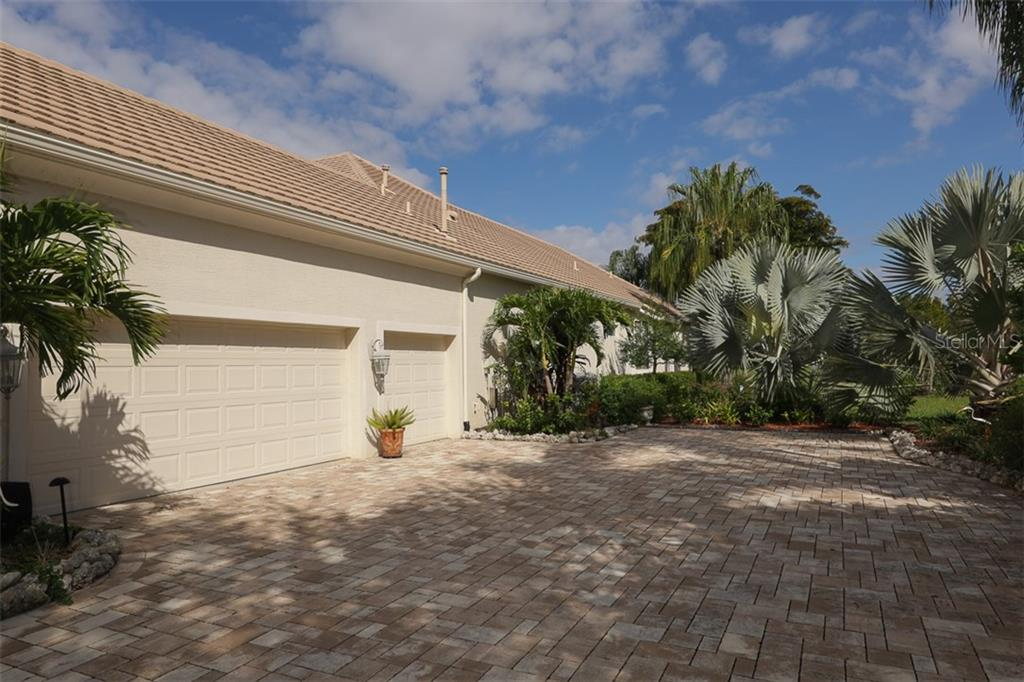Single Family Home for sale at 7927 Warwick Gardens Ln, University Park, FL 34201 - MLS Number is A4457970