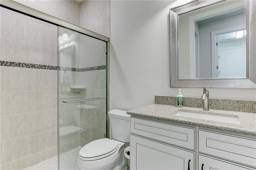 Bathroom 3 Main Level - Single Family Home for sale at 6859 Chester Trl, Lakewood Ranch, FL 34202 - MLS Number is A4458594