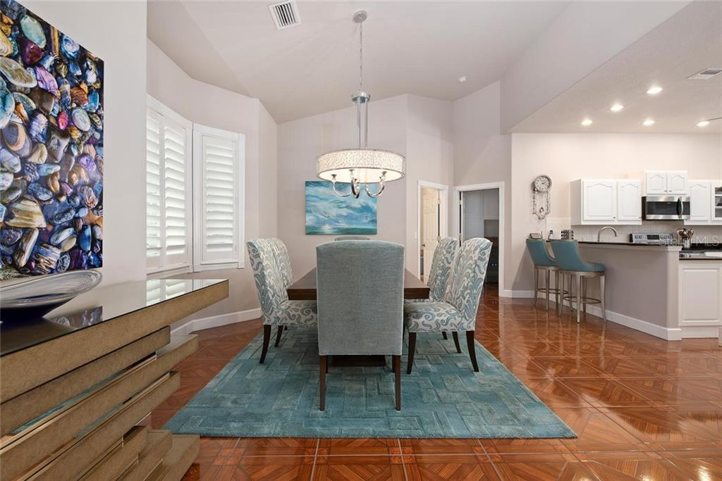 Dining room, kitchen - Single Family Home for sale at 448 Baynard Dr, Venice, FL 34285 - MLS Number is A4459566