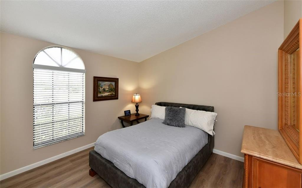 Bedroom is spacious with step in closet with inserts for optimal storage. - Condo for sale at 4613 Morningside #30, Sarasota, FL 34235 - MLS Number is A4460777