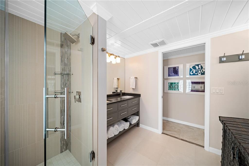 Master bath en-suite - Single Family Home for sale at 8334 Sanderling Rd, Sarasota, FL 34242 - MLS Number is A4461606