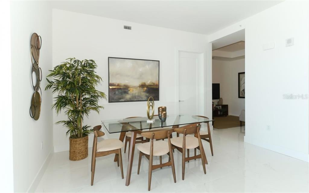 Dining area, entrance to den/office - Condo for sale at 111 S Pineapple Ave #1117 L-1, Sarasota, FL 34236 - MLS Number is A4461778