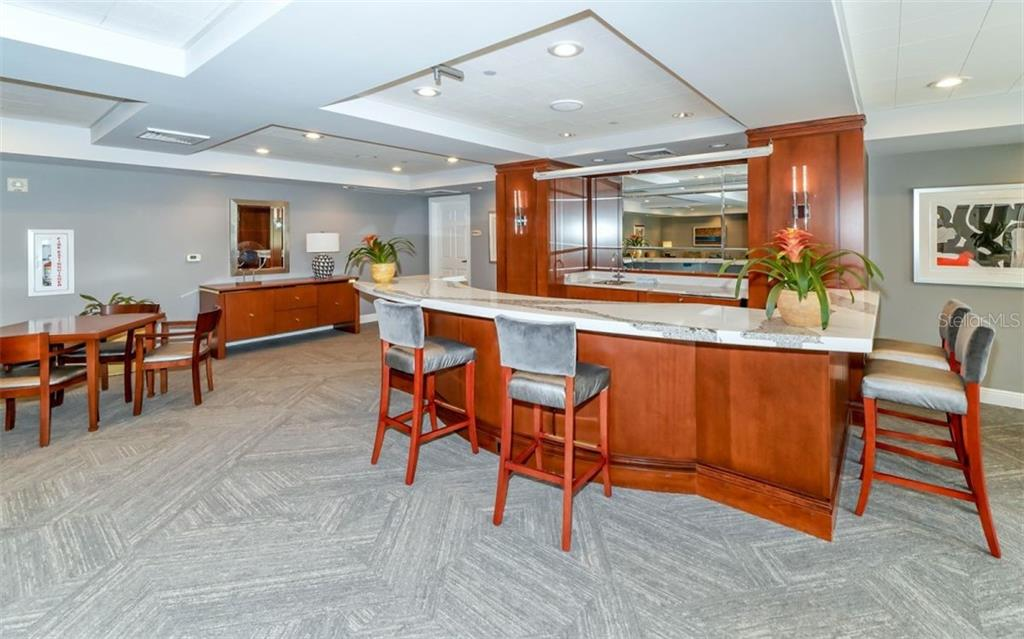 Wet bar in the social room - Condo for sale at 100 Central Ave #A401, Sarasota, FL 34236 - MLS Number is A4463296