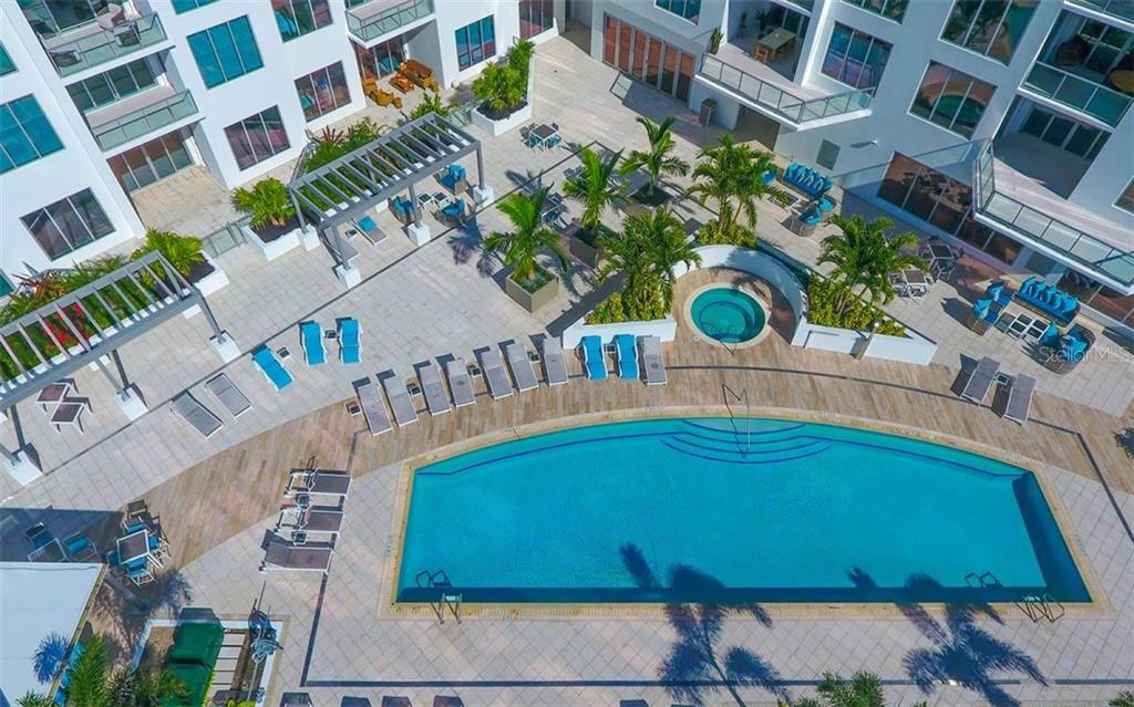 Resort-style pool, spa, bbq area and cabanas to relax under. - Condo for sale at 111 S Pineapple Ave #610, Sarasota, FL 34236 - MLS Number is A4463717