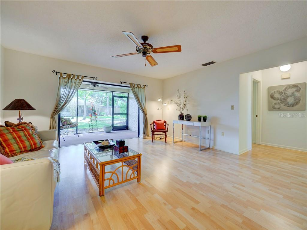 Living Room looking outside through Screened Porch - Villa for sale at 4335 Rum Cay Cir, Sarasota, FL 34233 - MLS Number is A4463762