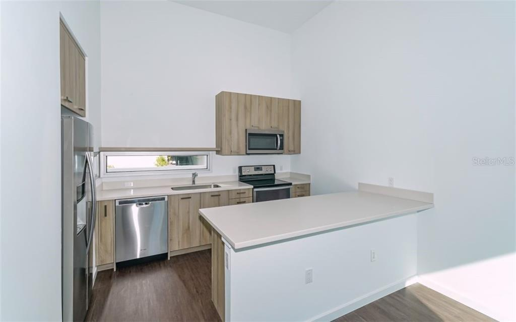 Tasteful modern finishes and stainless steel appliance. - Condo for sale at 1350 5th Street #104, Sarasota, FL 34236 - MLS Number is A4463799
