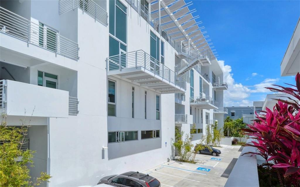 Secure motor court between the towers offers guest and resident parking. - Condo for sale at 1350 5th Street #104, Sarasota, FL 34236 - MLS Number is A4463799