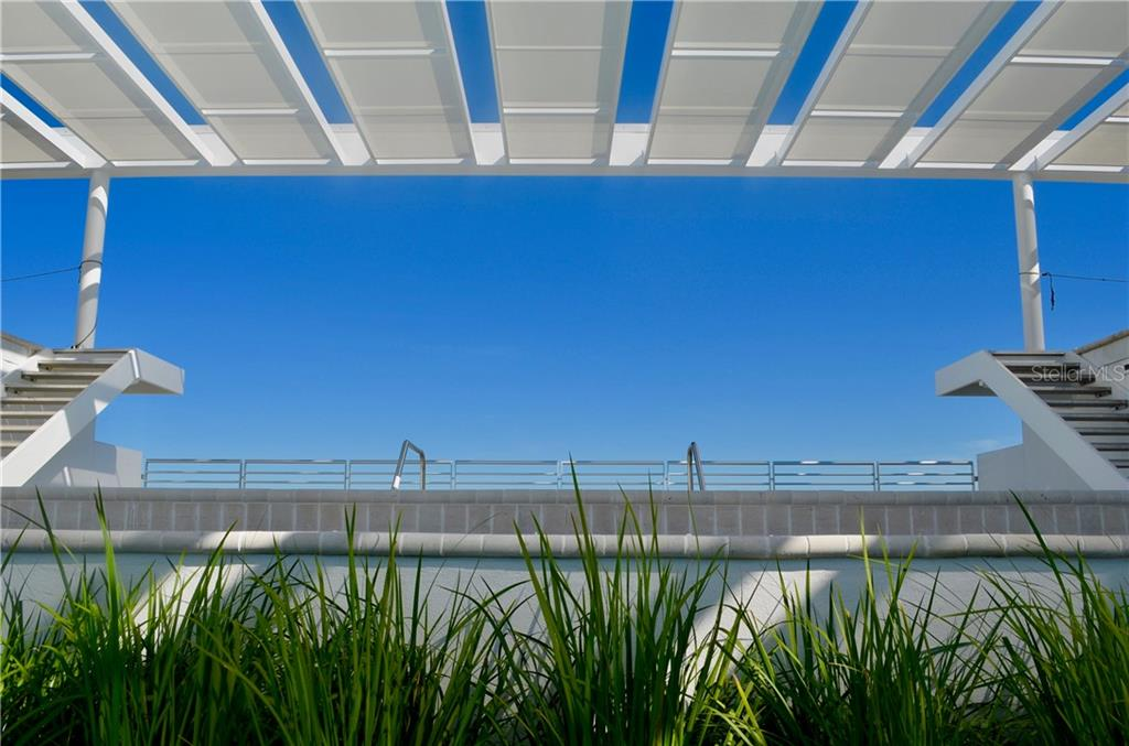 Beautiful sun shelves above the roof top pool terrace offers shade as your with. - Condo for sale at 1350 5th Street #104, Sarasota, FL 34236 - MLS Number is A4463799