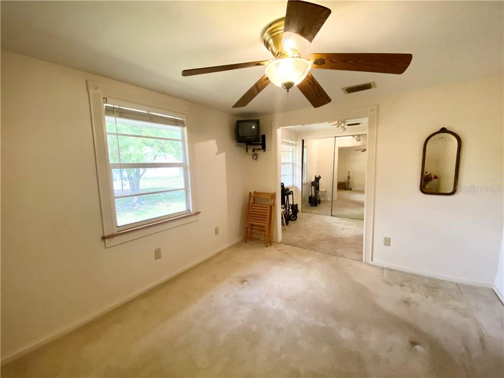 Second bedroom, view to the changing room. - Single Family Home for sale at 4300 Eastern Pkwy, Sarasota, FL 34233 - MLS Number is A4464200