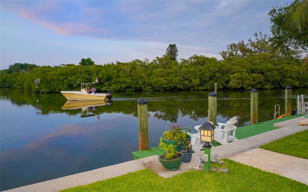 JUMP INTO YOUR KAYAK, BOAT OR JUST THROW A POLE IN TO FISH! - Single Family Home for sale at 3 Winslow Pl, Longboat Key, FL 34228 - MLS Number is A4464990