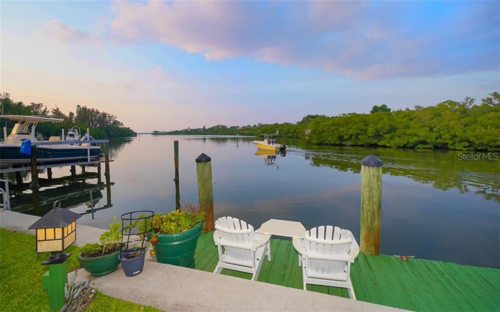 YOUR PRIVATE SUNSET DOCK HAS WATER & ELECTRICITY - Single Family Home for sale at 3 Winslow Pl, Longboat Key, FL 34228 - MLS Number is A4464990