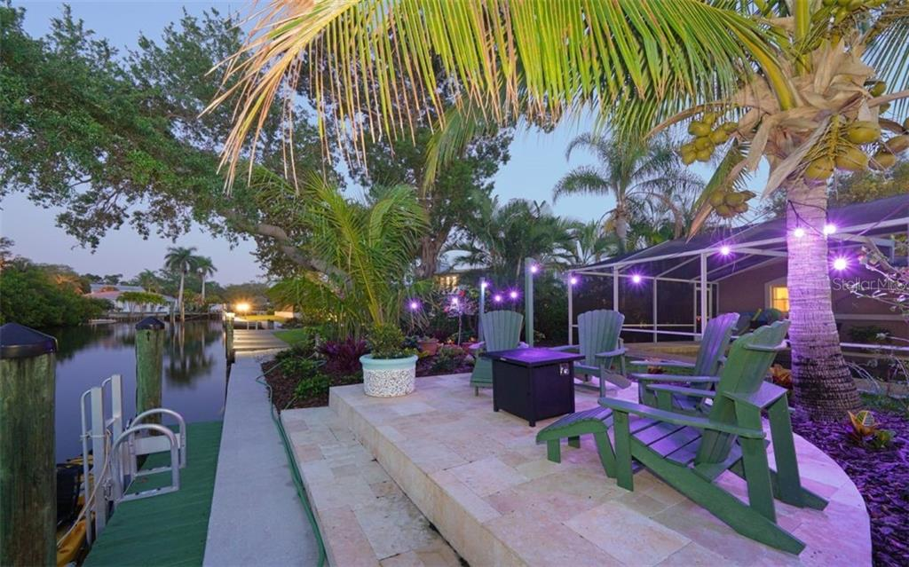 THE LADDER ON YOUR DOCK FOR  AN EVENING SWIM - Single Family Home for sale at 3 Winslow Pl, Longboat Key, FL 34228 - MLS Number is A4464990