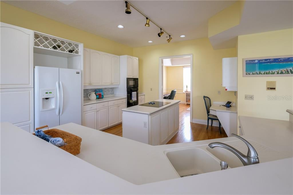Kitchen islands and desk. - Condo for sale at 515 Forest Way, Longboat Key, FL 34228 - MLS Number is A4465231