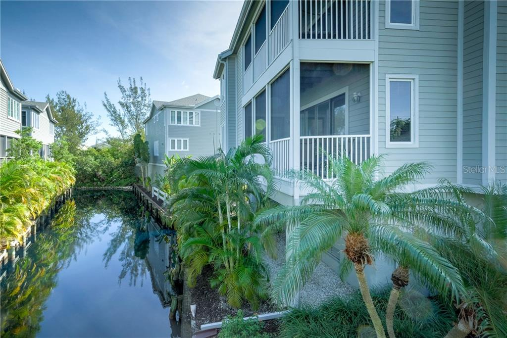 View of both decks over pond. - Condo for sale at 515 Forest Way, Longboat Key, FL 34228 - MLS Number is A4465231