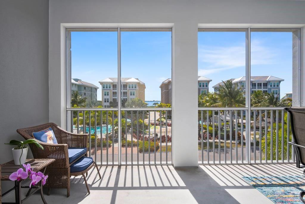 Screened Lanai overlooking the swimming pool and Anna Maria Sound - Condo for sale at 383 Aruba Cir #201, Bradenton, FL 34209 - MLS Number is A4466540
