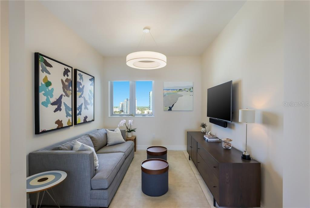 The den is located opposite the living room. - Condo for sale at 1155 N Gulfstream Ave #1404, Sarasota, FL 34236 - MLS Number is A4467921