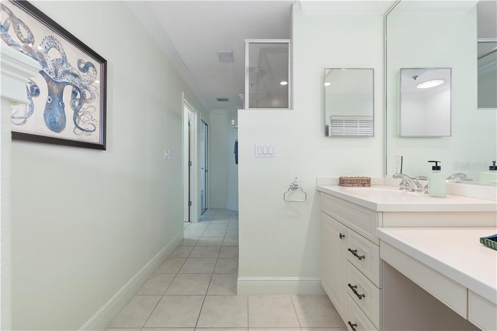 Master bathroom with dual vanities and walk in shower - Single Family Home for sale at 97 52nd St, Holmes Beach, FL 34217 - MLS Number is A4468151