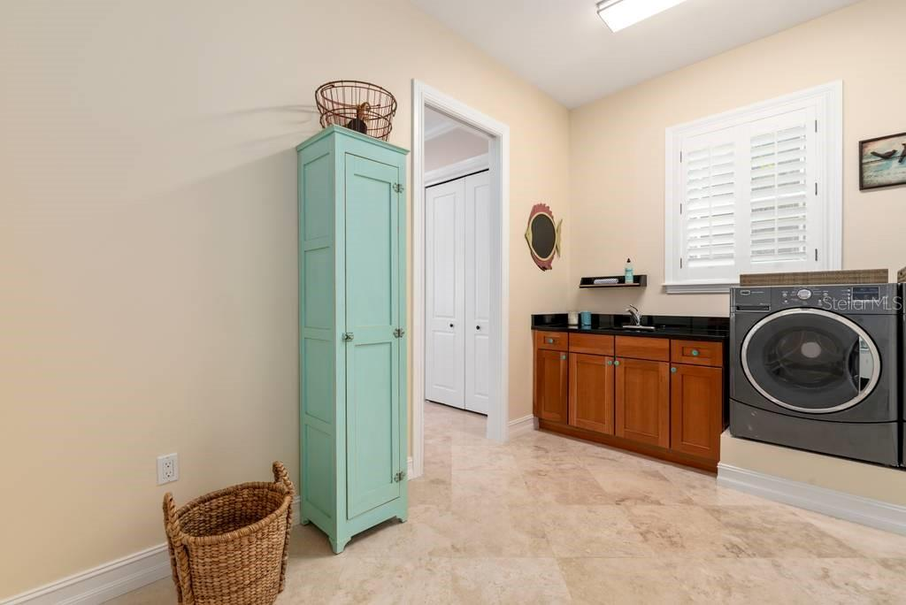 Laundry and entry into kitchen - Single Family Home for sale at 605 N Point Dr, Holmes Beach, FL 34217 - MLS Number is A4469001