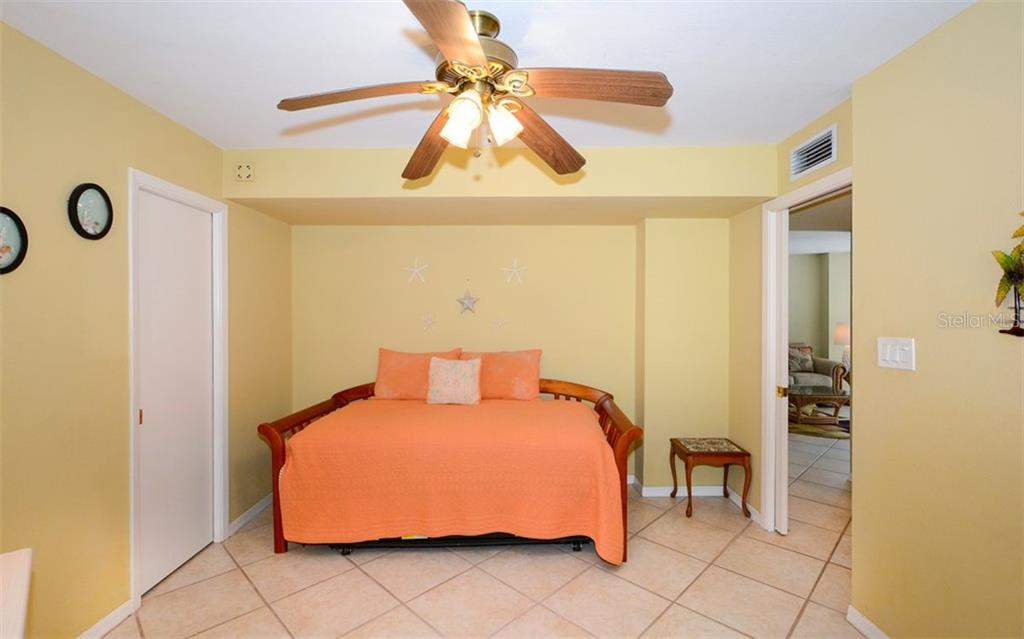 2nd bedroom with walk-in closet, trundle bed opens to queen size. - Condo for sale at 1770 Benjamin Franklin Dr #706, Sarasota, FL 34236 - MLS Number is A4469463