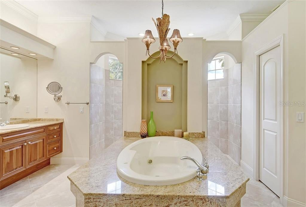 Master Bath - Single Family Home for sale at 9025 Rocky Lake Ct, Sarasota, FL 34238 - MLS Number is A4470339